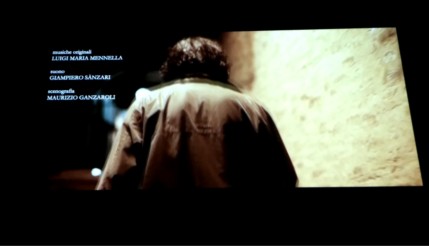 """image of the film screening which shows Luigi Maria Mennella as music composer of the movie """"Un Padre"""" by Roberto Gneo starring Luca Lionello"""